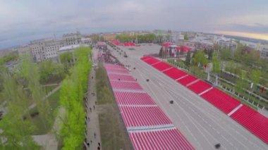Military motorcade moves along square