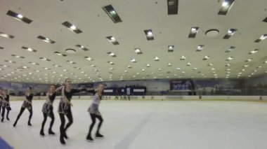 Skaters perform synchronized dance on ice