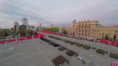 Soldiers stand on square during rehearsal of parade