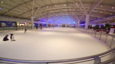 Children skating on indoor rink in Aviapark