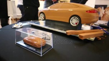 Clay model of car in glass box