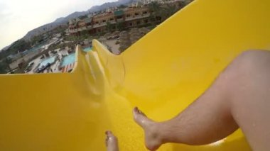 Man sliding in water park