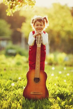 Cute little girl with guitar