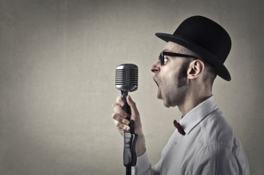 Man screaming in a microphone