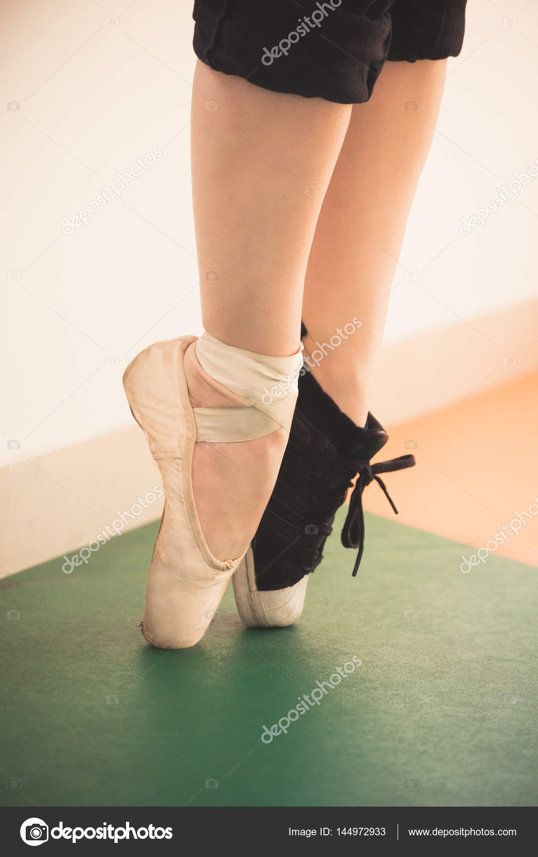 girlfeet Dancer girl feet in sneakers and ballet shoes closeup – Stock Image