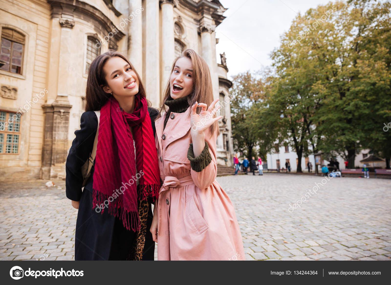 Pretty girls in coats on the street — Stock Photo © Vadymvdrobot