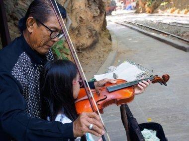 Kanchanaburi, Thailand - December 25,2516 : Asian musician violi