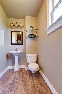 Half bathroom interior with beige walls and white appliances