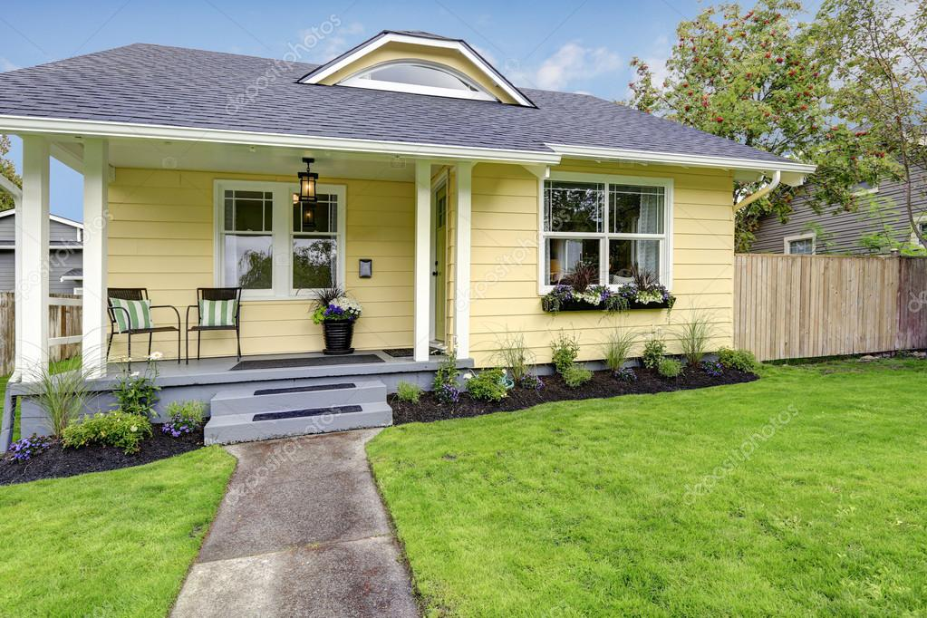 Small American Yellow House Exterior Stock Photo
