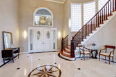 Foyer with curved staircase stock photo lmphot 8657675 for Carrelage mural hall d entree