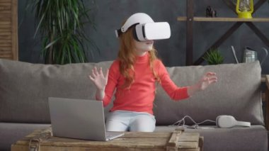 Little girl in VR headset
