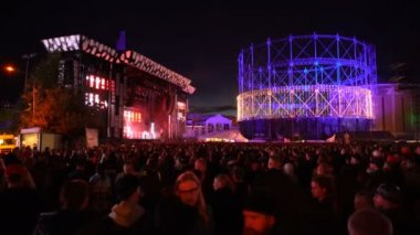 A huge crowd in front of the stage during the music festival