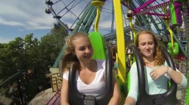 Children ride on a merry ride in the Amusement Park. Slow motion