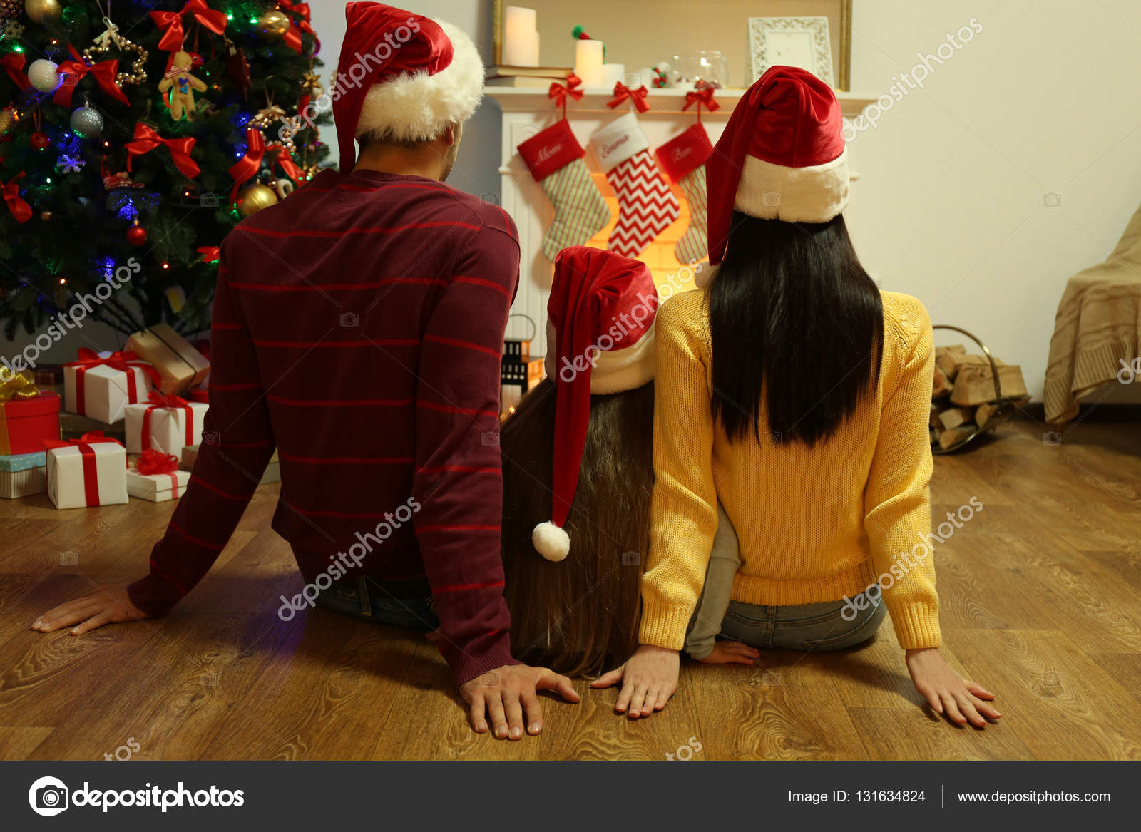Of Living Rooms Decorated For Christmas Family Sitting Near Fireplace In Living Room Decorated For