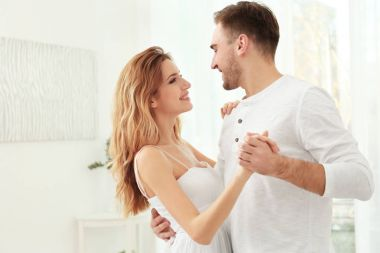 Young couple dancing at home
