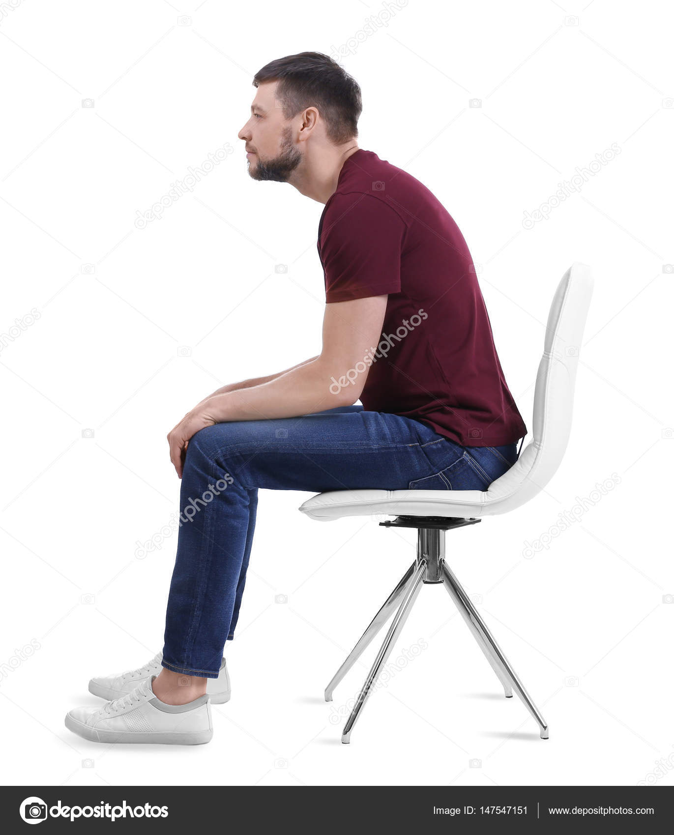 Man Sitting On Chair Stock Photo 147547151