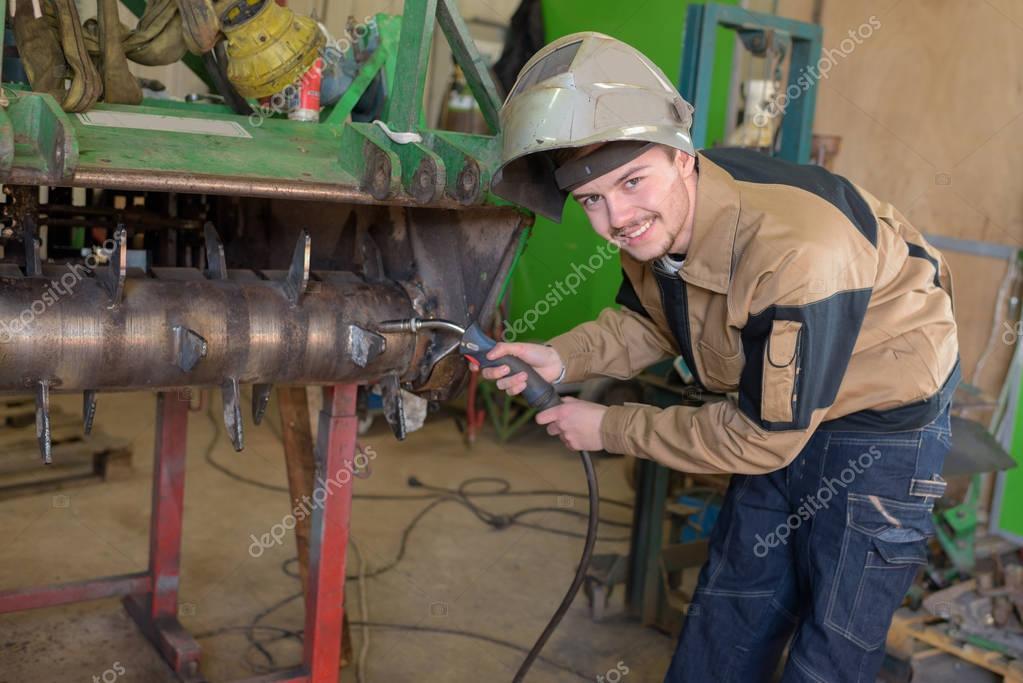 Happy apprentice welder at work in the plant — Stock Photo ...