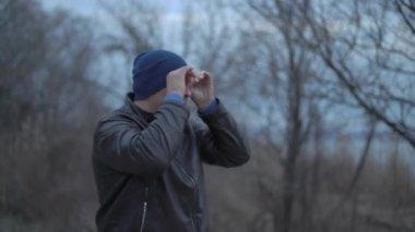 The Man Looks at The Improvised Binoculars Looks Ahead Turns. Looks at us and Again Turns Away Looks Ahead