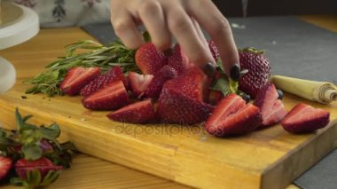 Close Up Female Hands Slicing Fresh Organic Strawberries - Female using sharp knife cut fresh organic strawberries fruit to eat part healthy lifestyle diet hands only