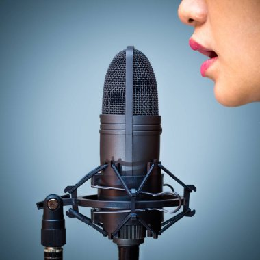 Asian female singer mouth singing on microphone
