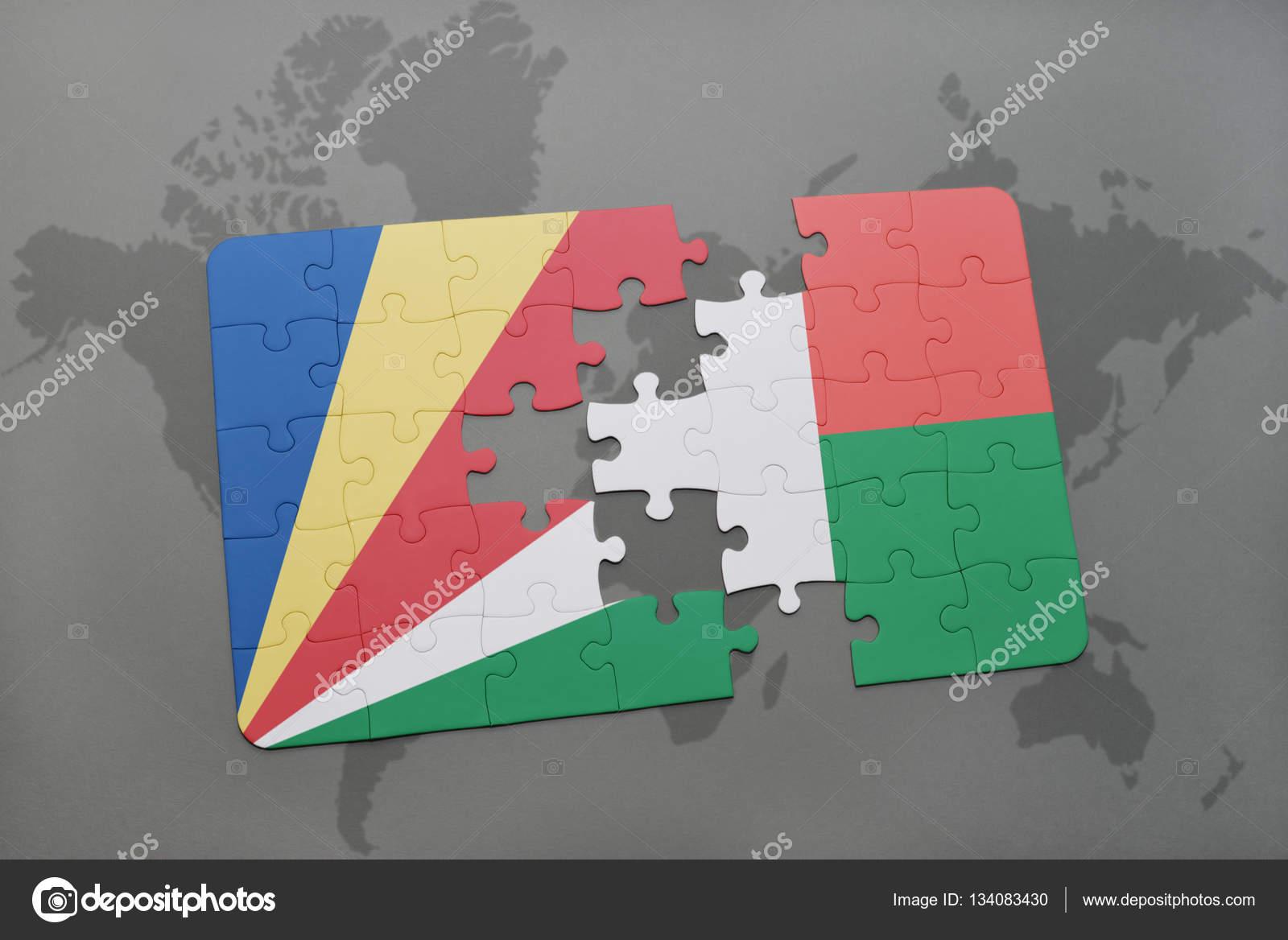 益智与塞舌尔和马达加斯加的国旗在世界地图背景上.3d 图