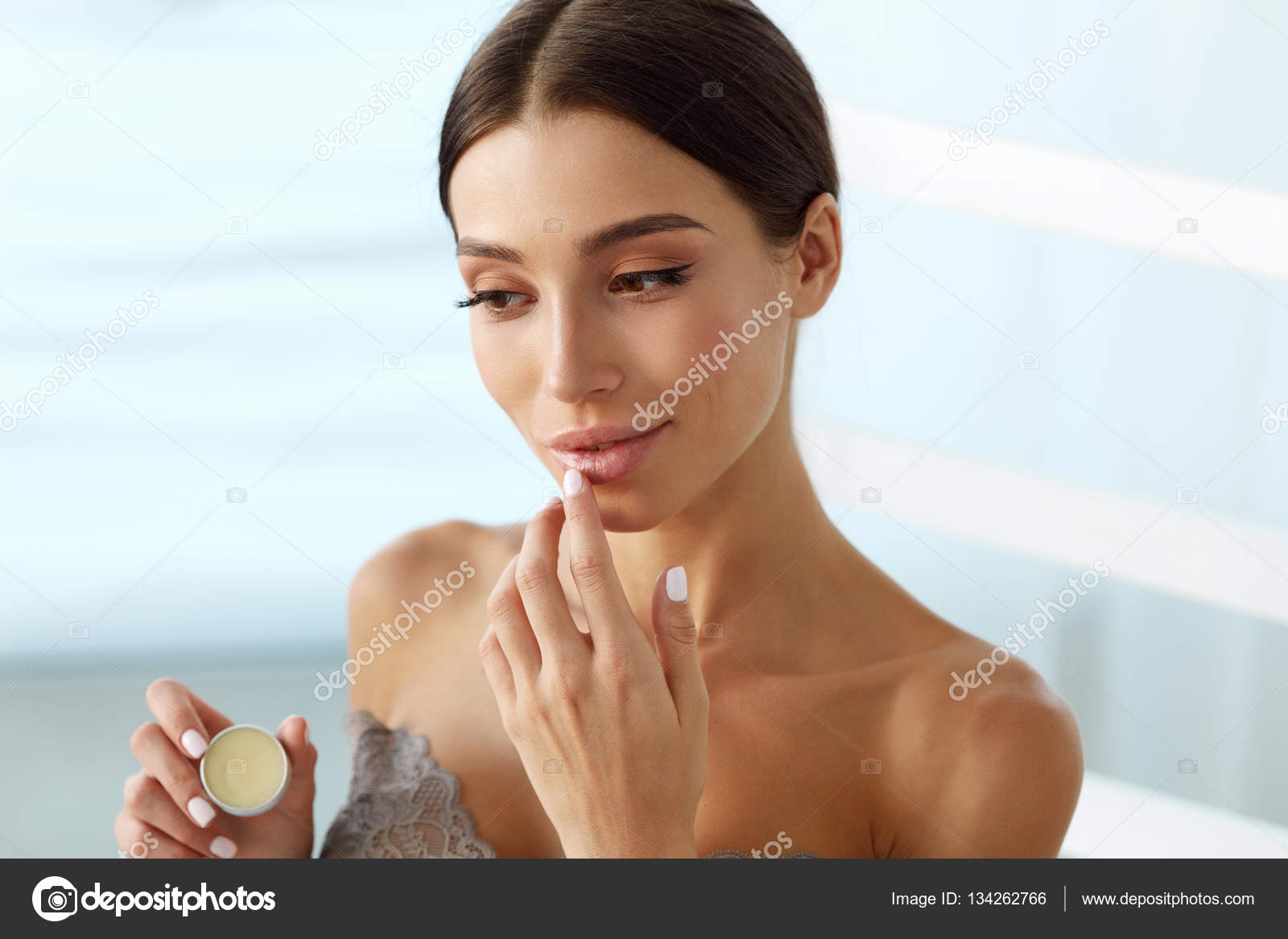 Lips Skin Care. Woman With Beauty Face Applying Lip Balm ...