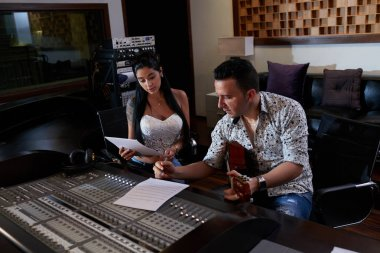 Singer and musician writing new song