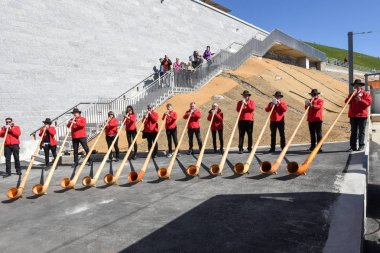 People playing the alphorn at Mount Generoso on Switzerland