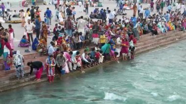 Hairdwar, India - March, 2017: The Ganges River with pilgrims on the holy ghats at Haridwar, Uttarakhand, India, sacred town for hindu people.