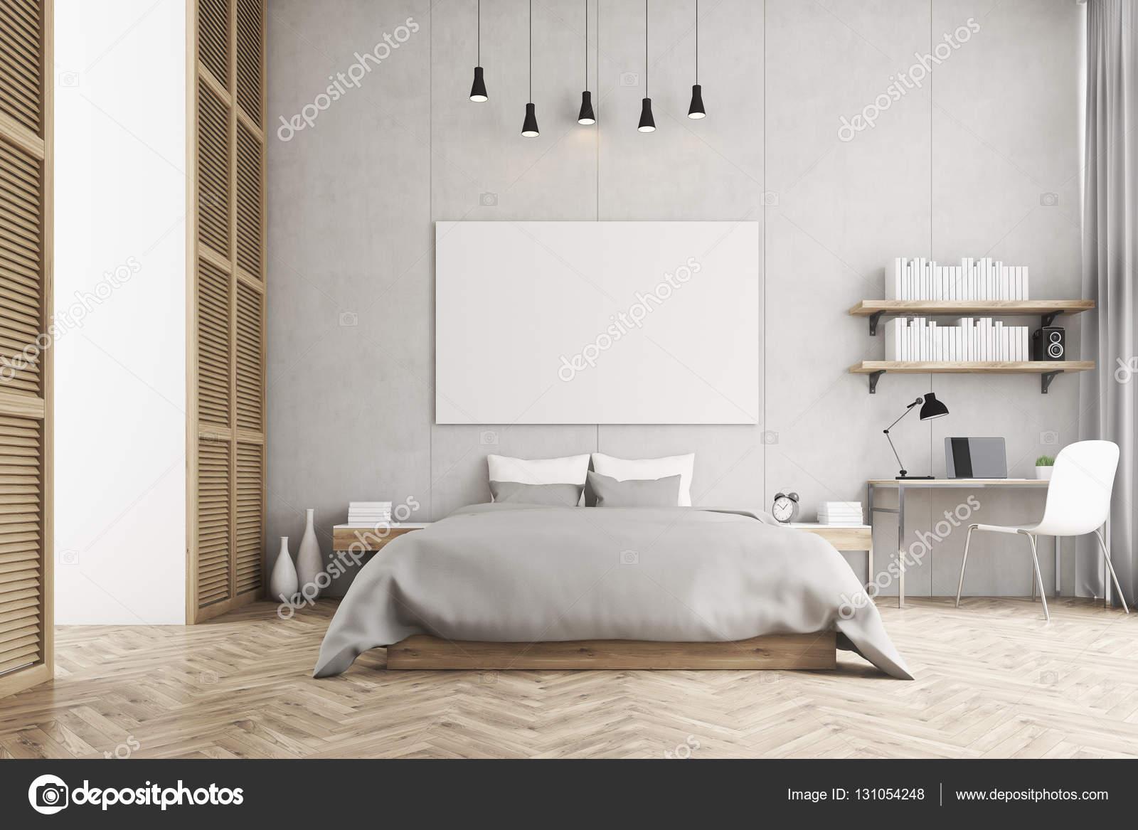Vista frontale di un letto king size e un angolo studio in for Grandi piani di una camera da letto