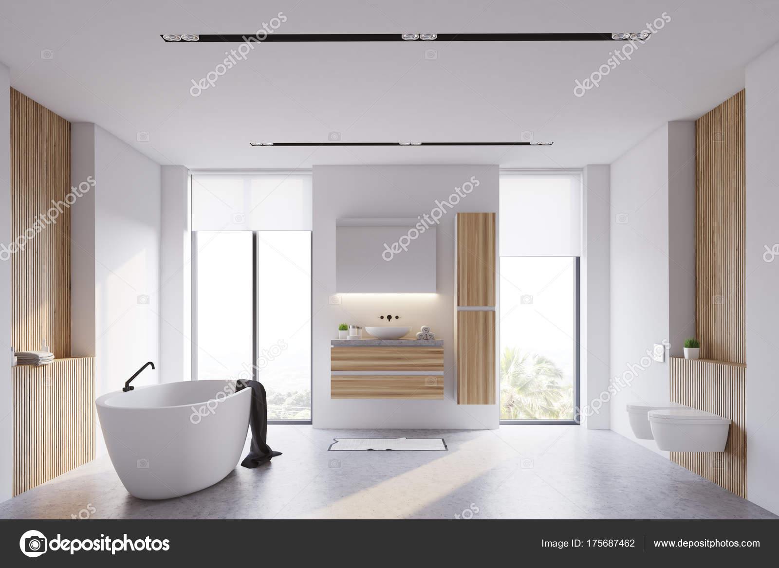 83c99c41ba free interno del bagno moderno con pareti bianche e in legno ampie finestre  un pavimento di cemento una vasca da bagno bianca e un lavandino con uno ...