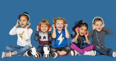 Adorable children listening music