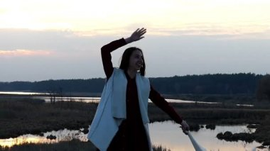 Girl Dancing With Shawl at Sunset in Slow Motion.