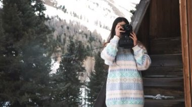 Girl with a vintage camera. Mountain travel