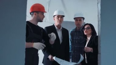 Managers talking to builder about plan