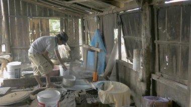 Man making rice noodles