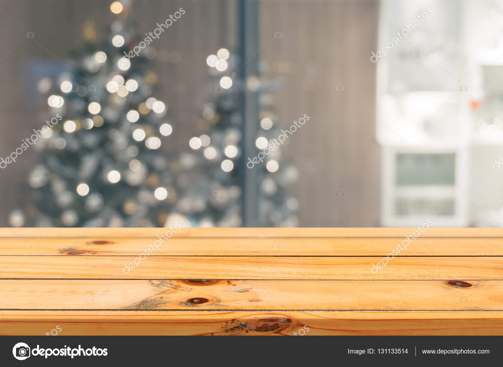 Wooden board empty table top on of blurred background. Perspective brown wood table over blur