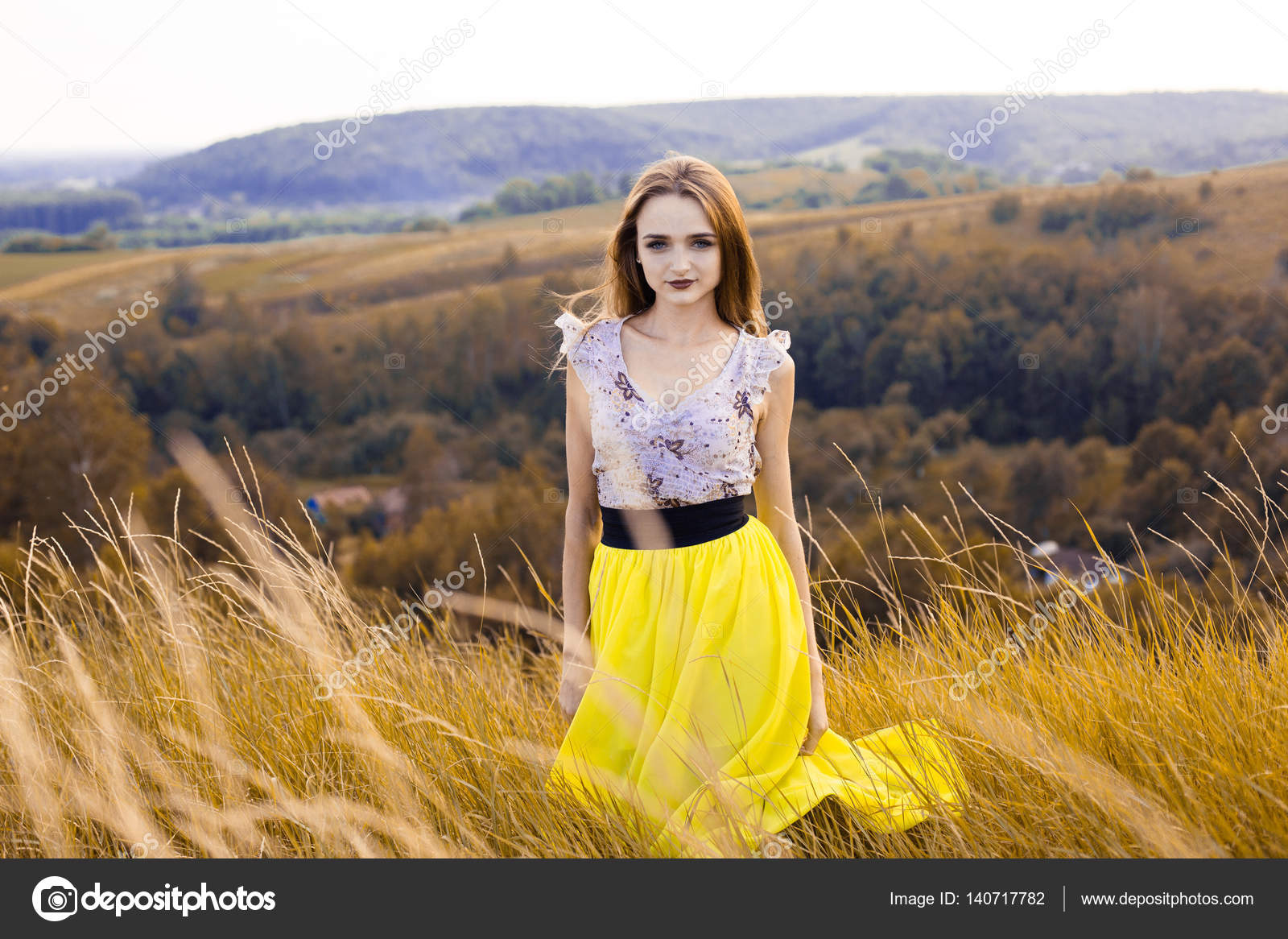 beautiful fashionable pretty gorgeous girl in dress on the