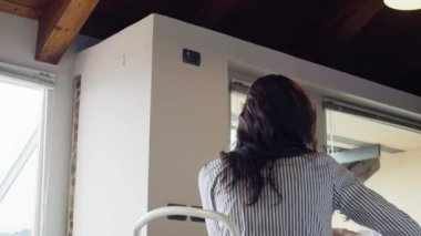 Man in hurry take bike to go to work kissing her girlfriend having italian breakfast indoor in modern industrial house. 4k video shot