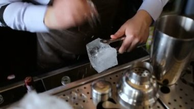 Barman prepares alcoholic cocktail in the bar