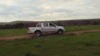 Man driving in safari jeep on trail
