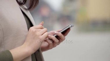 Woman Works on Smartphone - Closeup