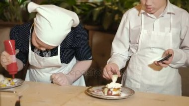 Happy family funny kids are preparing the dough, bake cookies in the kitchen 4k