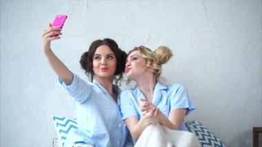 Two female friends doing selfie together. Concept of friendship.