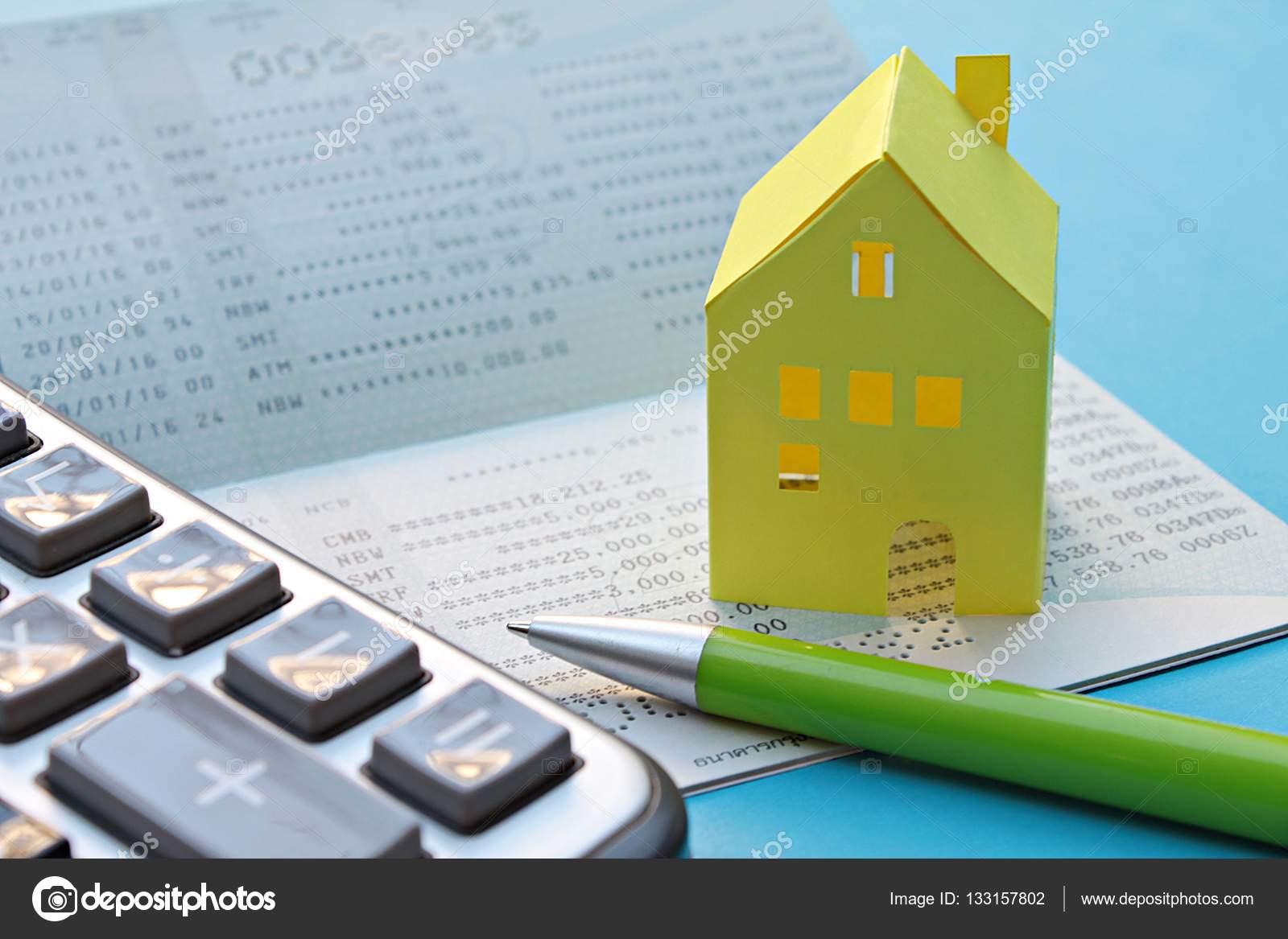 Savings account passbook calculator pen and yellow paper house – Savings Account Calculator