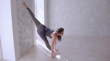 Beautiful young woman stretching