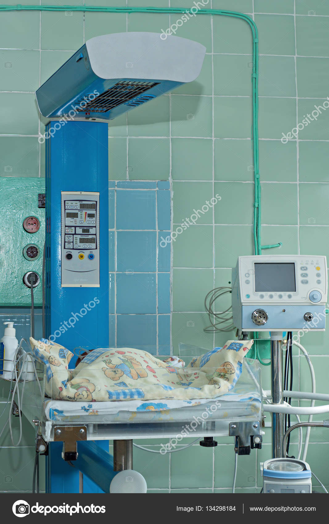 Newborn Baby On Infant Warmer In Neonatal Intensive Care Unit '�  Stock  Photo #134298184