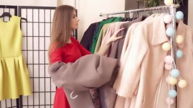 Woman taking the clothes to try on