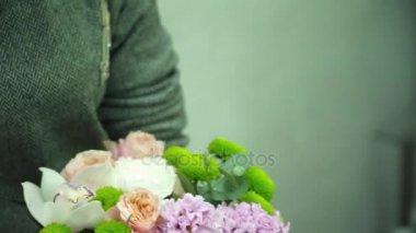 Florist making a beautiful bouquet closeup