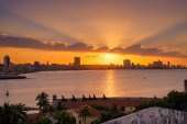 Beautiful sunset in Havana with the sun setting over the buildings